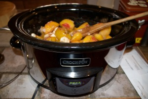 crock with peaches