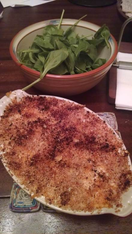 The eggs tore a bit when I shelled them, so the picture is of the pretty gratin dish plus the heaping amount of spinach.
